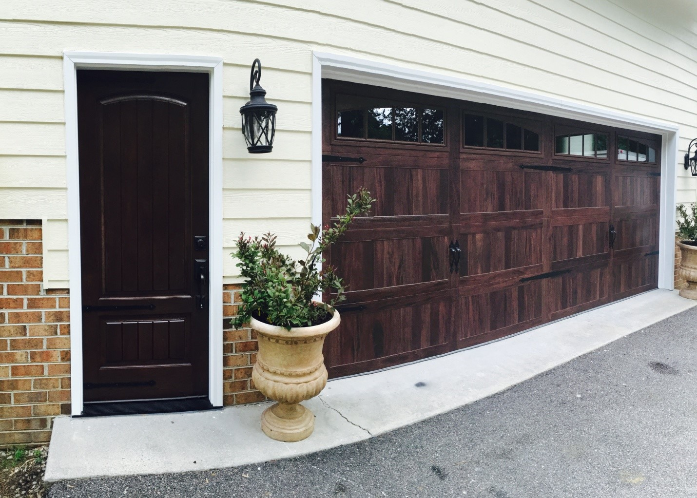 An Entry Door & Carriage House Garage Door Complement Each Other