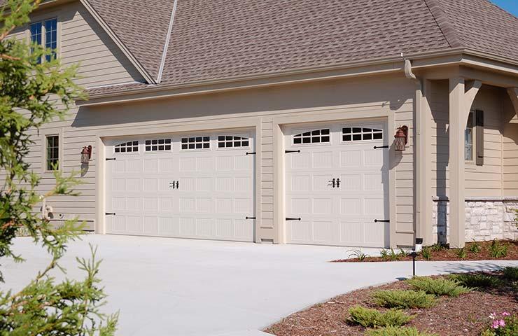 Chi Stamped Steel Carriage Garage Doors By Apple Door
