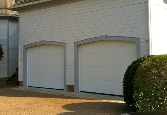Before   Plain Looking Flush Style Garage Doors Which Kept With The  Contemporary Style Of This Home In Richmond, VA 20 Years Ago When It Was  Built.