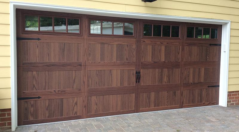 Stamped Carriage House Garage Door Gives New Curb Appeal